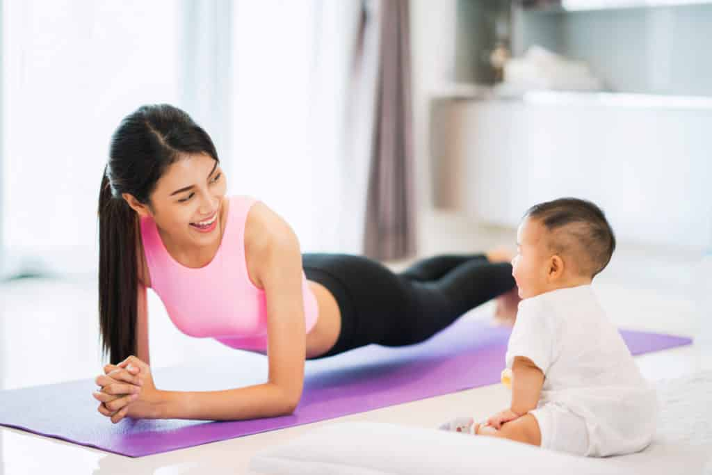 Mom planking in front of a child