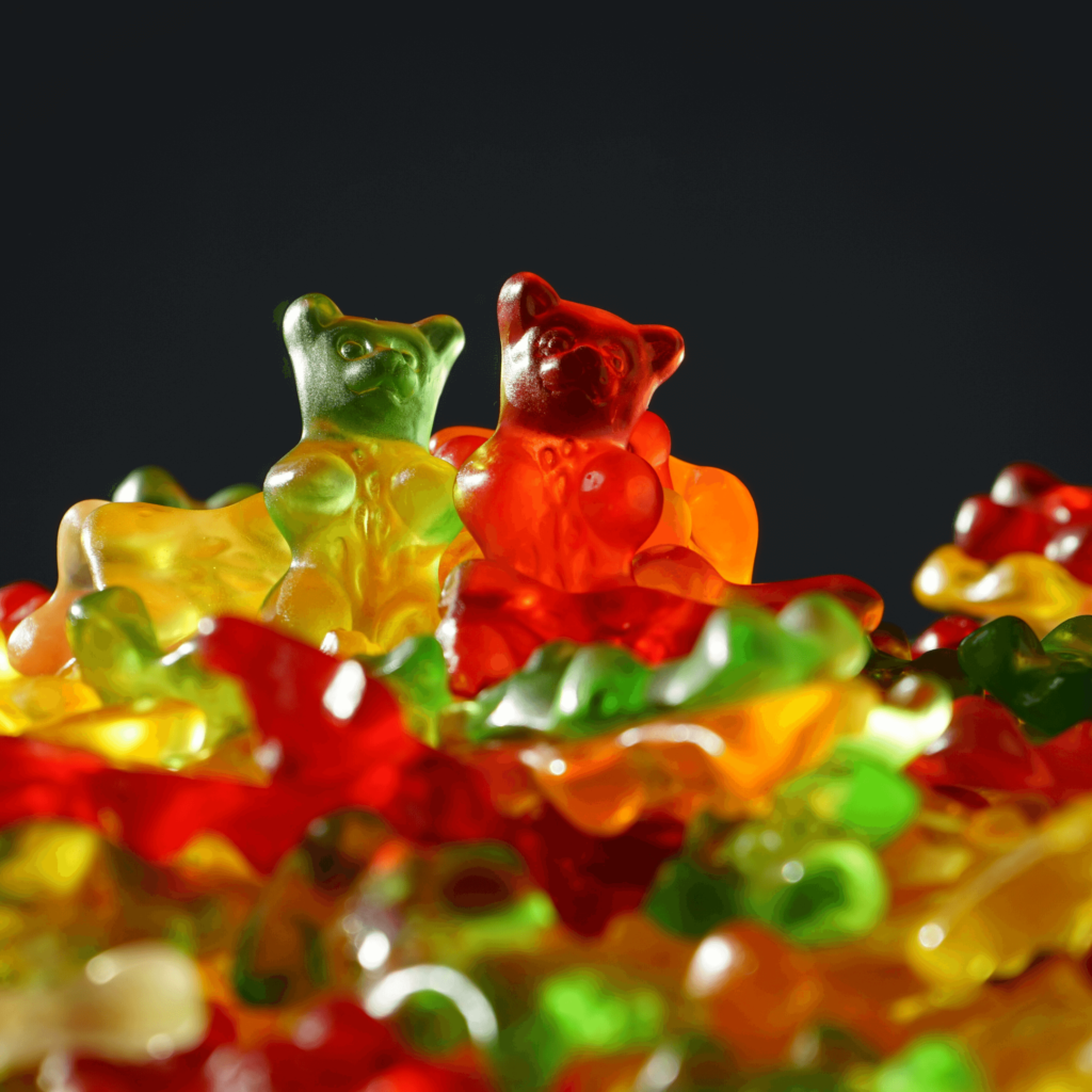 These are usually small fruit gum candies which contain sugar, starch and citric acid. Although the recipes for each flavour vary, the citric acid component present in gummy bears would provide some respite from nausea and irritation.
