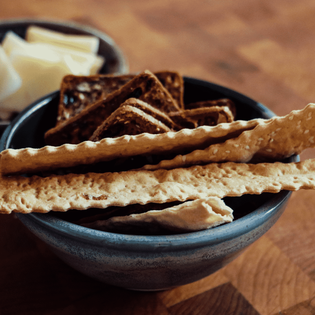 Dry crackers absorb stomach acid. Eating them can help settle a quesy tummy.