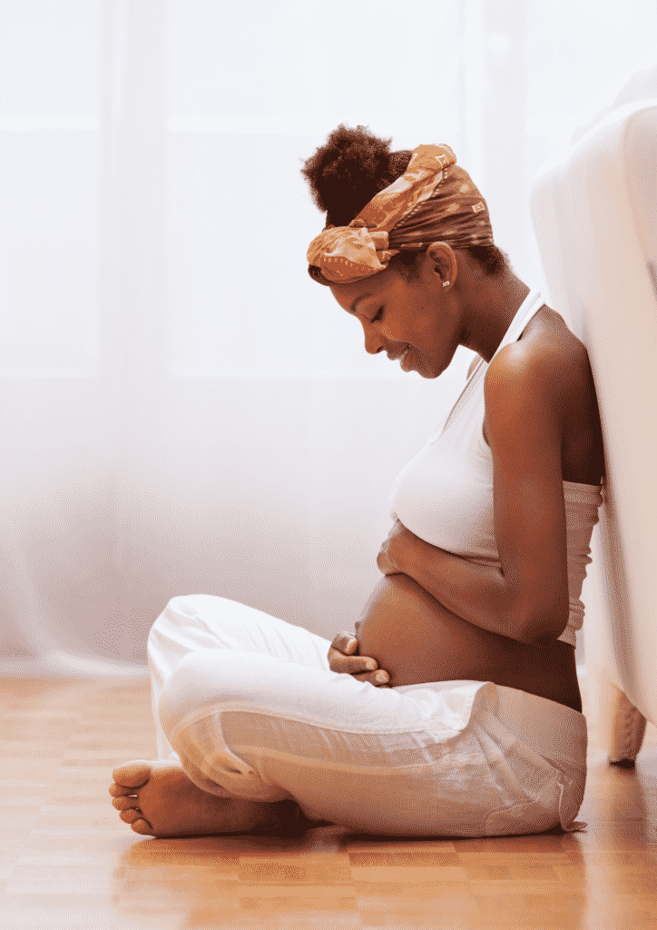 Sit in a comfortable position to bein your breathing exercises during pregnancy