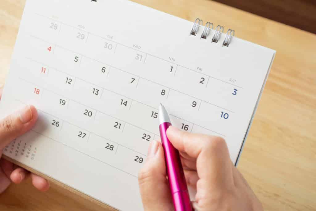 pen and calendar calculating pregnancy period