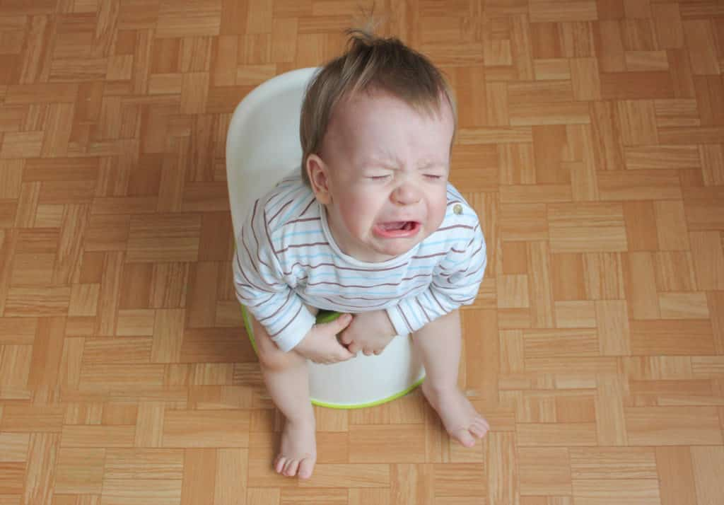 baby crying on a potty